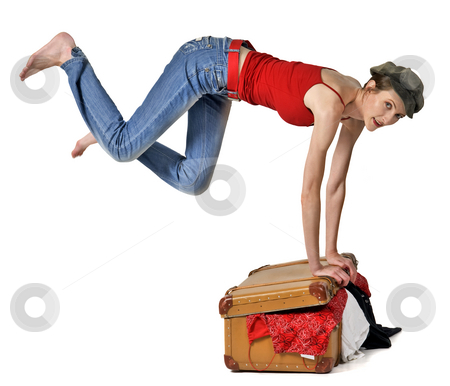 Travel stock photo, Jumping girl put in order baggage in trunk by Desislava Draganova