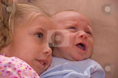 Baby Brother and Sister stock photo, This cute shot of siblings is a 4 year old girl snuggling with her 2 month old baby broth, both are bi-racial beautiful children. by Valerie Garner