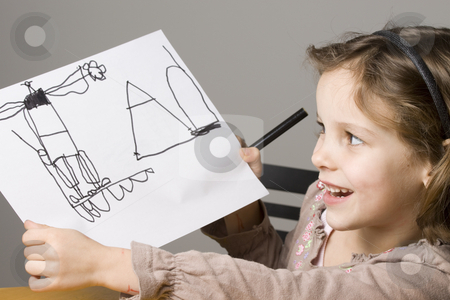 Little girl showing her drawing stock photo, Proud Little girl showing her drawing by Jandrie Lombard