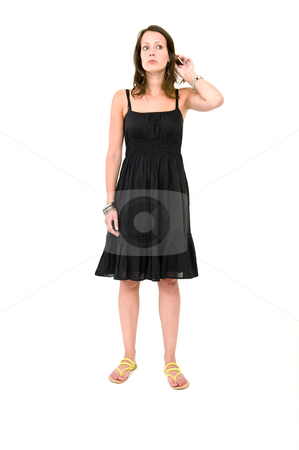 Woman - hearing something stock photo, Full body portrait of a young brunette woman in a black summer dress, lifting her hear and listening by Corepics VOF