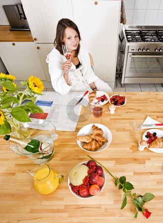 Champagne breakfast stock photo, Young woman enjoying a rich champagne breakfast by Corepics VOF