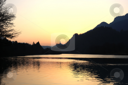 Colorful Sunset in the mountains stock photo, Lake, church and forest at a colorful sunset by Ervin Monn
