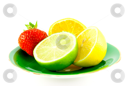 Citrus Fruit on a Green Plate stock photo, Lemon, lime and orange halves on a fancy green plate with a red juicy strawberry on a white background by Keith Wilson