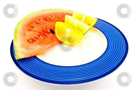 Watermelon with Citrus Wedges stock photo, Slice of red juicy watermelon with a lemon, lime and orange wedge on a blue plate with a white background by Keith Wilson