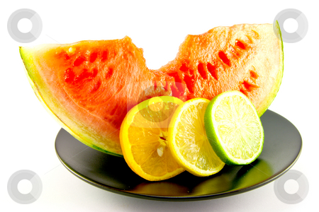Watermelon with Slice of Lemon, Lime and Orange stock photo, Slice of red juicy watermelon with a slice of lemon, lime and orange on a black plate with a white background by Keith Wilson