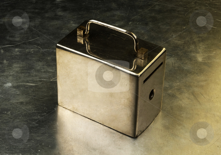 Savings stock photo, Metal money box on a metal background by Desislava Draganova