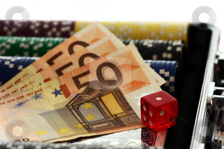 Poker stock photo, Pokerchips with money by Andre Janssen