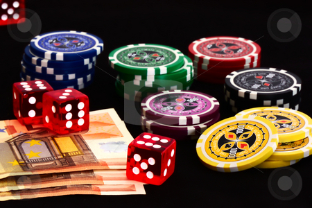 Poker stock photo, Pokerchips mit money and dices by Andre Janssen