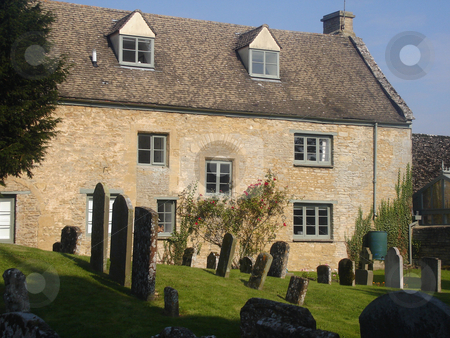 House Next To A Cemetary In England stock photo, Small cottage Next To A Cemetary In England by Philip Muller