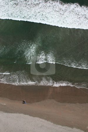 Two surfers walking along the beach, aerial view stock photo, Aerial view of two surfers walking along the beach Las Machas in Arica Chile by Philip Muller