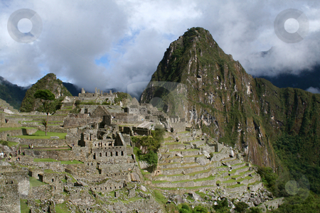 Landscape view of Machu Picchu and Mount Huayna Picchu stock photo, Landscape view of the lost city of Machu Picchu and Mount Huayna Picchu by Philip Muller