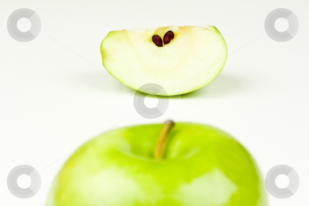 Apple and Slice stock photo, An apple top and apple slice by Patrick Noonan