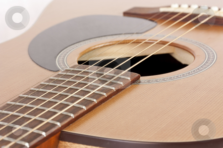 Acoustic Guitar stock photo, Close-up of an acoustic guitar by Patrick Noonan
