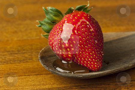 Strawberry with Honey stock photo, A strawberry with a honey glaze by Patrick Noonan