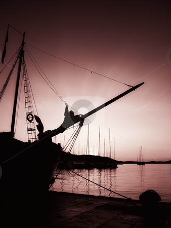 Magenta sunset stock photo, Toned image and silhouette of an old ship in the Adriatic port in the quiet and tranquil  evening. by Sinisa Botas