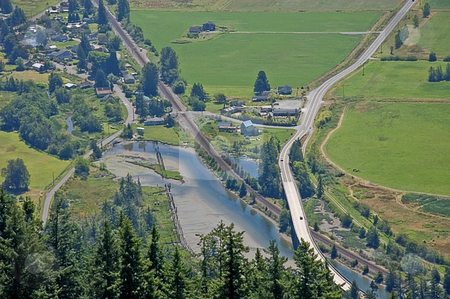 Aerial View of Small Community Farmland stock photo, This aerial view is of a small community farmland of Blanchard Washington with it's roads and Samish River running through. by Valerie Garner