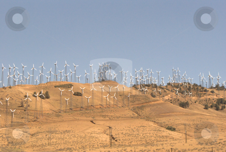 Green energy stock photo, A wind farm in the California desert. by Stephen Hagspiel