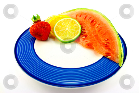 Watermelon with Citrus Slices and Strawberry stock photo, Slice of red juicy watermelon with lemon, lime and orange slices and single strawberry on a blue plate with a white background by Keith Wilson