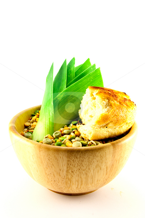 Soup Pulses with Leek and Crusty Bread stock photo, Wooden bowl of soup pulses with leek and crusty bread on a white background by Keith Wilson