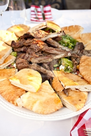 Lamb Ribs stock photo, Grilled lamb ribs with pita bread and vegetables. by Mariusz Jurgielewicz