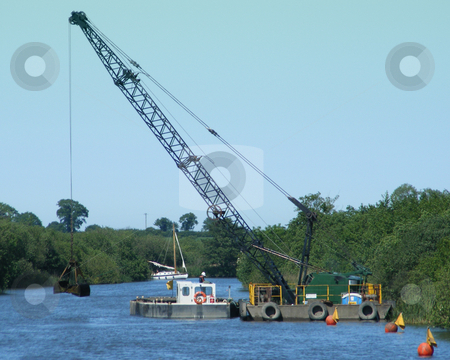 Dredging Machine 1 stock photo, Dredging Machine at work on the broads by Stuart Atton