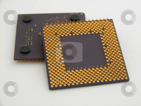 Cpus 1 stock photo, A pair of CPUs with gold pins by Stuart Atton