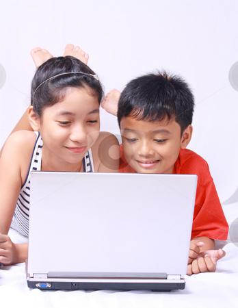 Computer kids stock photo, Asian kids sharing and enjoying laptop computer by Claro Alindogan