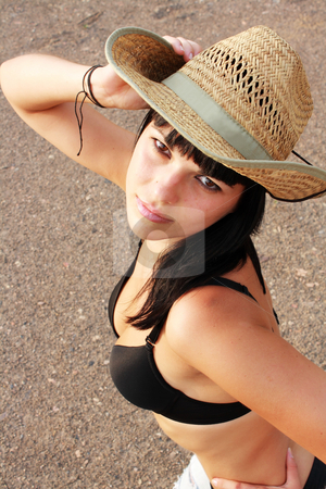 Portrait teenager in yellow hat stock photo, Portrait teenager in jeans and yellow hat by Sergii Mogyla