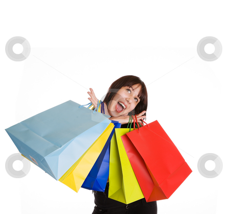 Happy shopper stock photo, A beautiful mixed race woman with many shopping bags by Steve Mcsweeny
