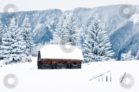 Old stable in winter stock photo, Old stable in winter in the mountains with snow by Mircea Struteanu