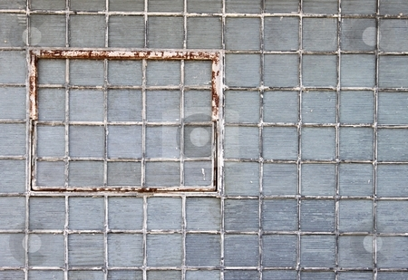 Glass Brick Wall stock photo, Glass brick wall with a rusty window by Henrik Lehnerer