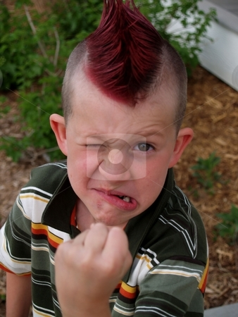 Mean kid stock photo, Kid with a mohawk looking angry, and ready to fight. by Cora Reed