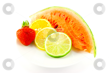 Citrus Fruit with Strawberry and Melon stock photo, Slices of lemon, lime and orange with a ripe red strawberry and slice of juicy watermelon on a white background by Keith Wilson