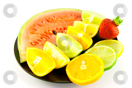 Watermelon with Citrus Wedges, Slices and Strawberry stock photo, Slice of juicy red watermelon with lemon, lime and orange wedges and slices and single red strawberry on a black plate with a white background by Keith Wilson
