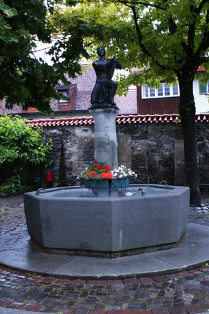 Old Fountain in with minstrel Bregenz stock photo, Brunnen mit Minnes???nger in bregenzer Altstadt / Old Fountain in with minstrel Bregenz by Thomas K?