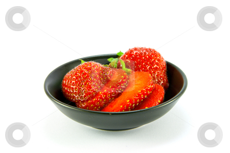 Strawberries in a Small Black Dish stock photo, Sliced and whole red fresh strawberries in a small black dish on a white background by Keith Wilson