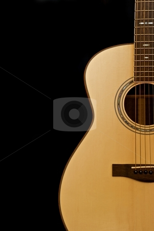 Acoustic Guitar stock photo, Acoustic guitar shown against a black background. by Chris Yates