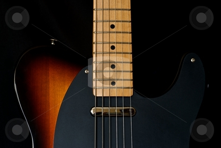Electric Guitar stock photo, Sunburst electric guitar on a black background. by Chris Yates