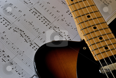 Guitar Music stock photo, Electric guitar shown next to sheet music. by Chris Yates