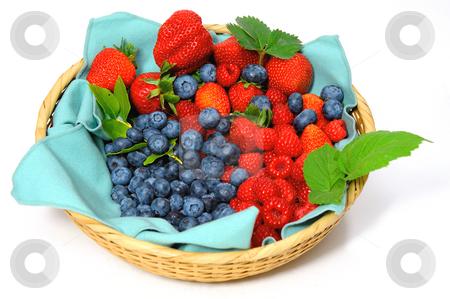 Blueberries, Strawberries and Raspberries stock photo, Assorted seasonal berries in a wicker basket including blueberry, strawberry and raspberry by Lynn Bendickson