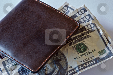 Wallet Money stock photo, $10 bills inside a folded wallet. by Chris Yates