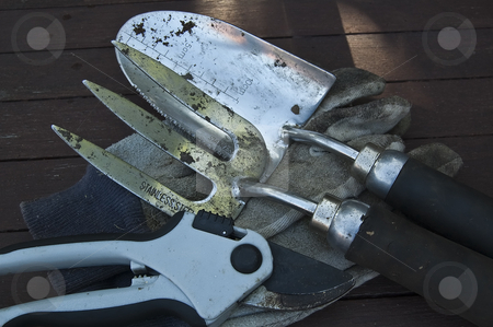 Gardening gloves, secteurs, fork and trowel stock photo, Some gardening tools. by Jeff Carson
