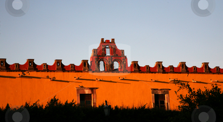 Red Yellow Building College San Miguel Mexico stock photo, Vigrant Red and Yellow Colored Building Colege, Civic Civica Plaza, San Miguel de Allende, Mexico by William Perry