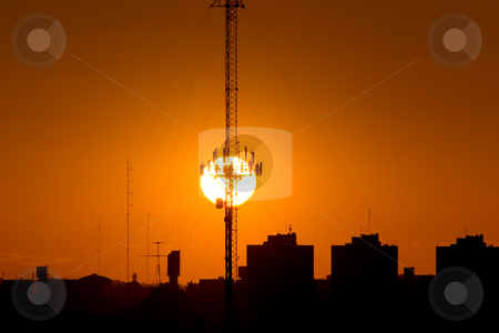 The Sunset and the Antenna stock photo, The Sun setting behind a telecommunications antenna, in Buenos Aires, Argentina. by Germán Ariel Berra