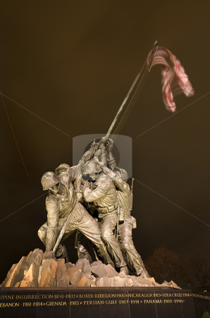 The Marine Corps War Iwo Jima Memorial Washington DC With Plane  stock photo, The Marine Corps War Memorial Shows the Raising of the Flag at Iwo Jima in World War II  Washington DC Statue finished in 1954  Plane Trail in Background by William Perry