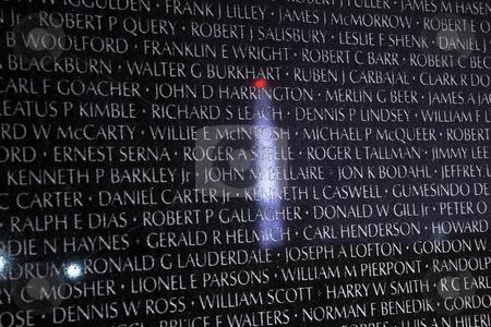 Washington Monument Reflection Closeup Vietnam Memorial Black Wa stock photo, Washington Monument Reflection Close Up Names on Vietnam Memorial Night The Wall Washington DC by William Perry