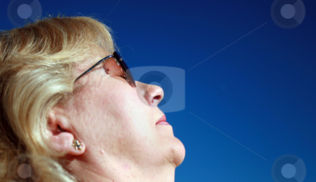 Woman Relaxing stock photo, A Woman Relaxing in the Sun in Florida. by Lucy Clark