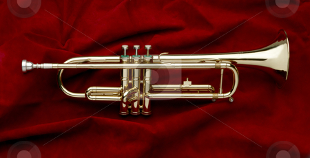 Shiny trumpet on red suede stock photo, Full shot of shiny trumpet on red suede background by James Barber