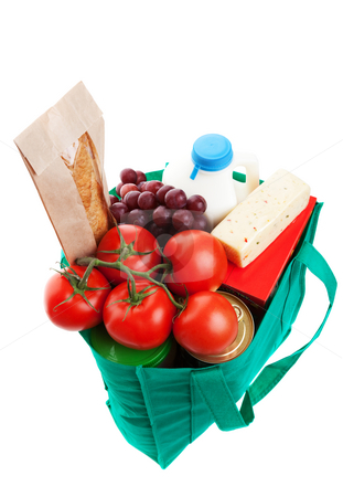 Groceries in Reuseable Bag stock photo, An eco-friendly, reusable, green cloth bag full of groceries.  Shot on white background. by Brenda Carson