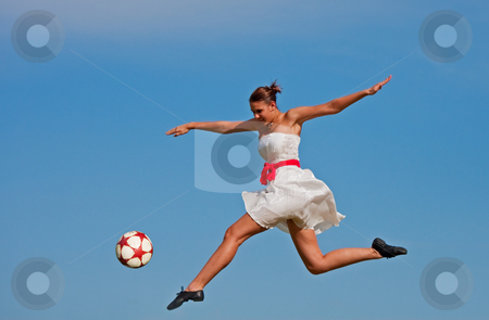 Soccer Beauty stock photo, A beautiful girl kicking a soccer ball with the grace of a ballet dancer. by Brenda Carson